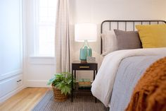 Boise Boys | Timber And Love | Luke Caldwell | HGTV | Realty | Mid Century modern | home renovation | Design | Boise Idaho | plants | bedroom | black bed frame     TRIM, DOOR, CEILING PAINT  |  CC-40 Cloud White  Benjamin Moore