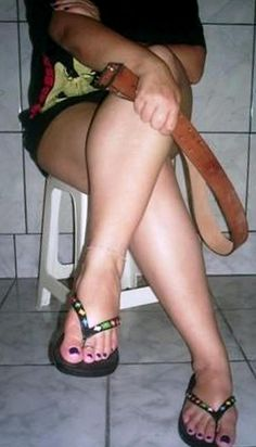 Spanked By Women Mistress Belt Sexy Legs Sandals Image