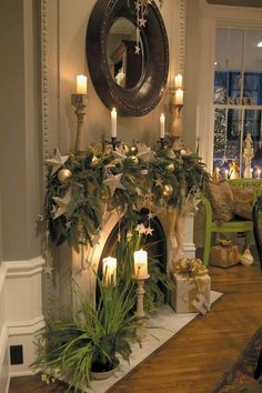 Christmas Elegant Mantle with greenery / candles.