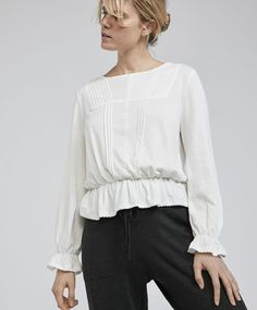 Victorian blouse, 19.99€ - Long sleeve blouse with a round neckline and elastic ruffle trims. Garment measurements: Total length from point of union between neckline and shoulder: 59 cm, sleeve length: 61 cm and chest width: 51.5 cm. These measurements are calculated based on a Spanish size M. - Find more trends in women fashion at Oysho .