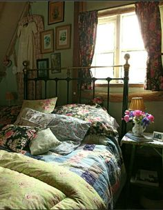 English  country, the upstairs bedroom when sterling moves down.  cover those mirrored doors with vintage fabric, magnets sewn in the seams will stick it flat to the metal frame.