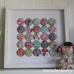 Fabric covered buttons -- framed! Brilliant idea!