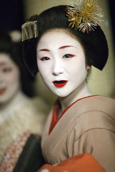 Japanese custom of Ohaguro - dyeing one's teeth black. It was most popular in Japan until the Meiji era and can be seen when Maiko enter the sakkou period.   In the olden days, most married Japanese women would blacken their teeth as some sort of a symbol of stature and pedigree. This is because in Japan, black color things were considered especially beautiful.
