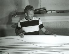 Hap Jacobs, Hermosa Beach, 1963. Surf legend HapJacobs handcrafts one of his prized surf boards. Today, a mint-condition Jacobs from this era can fetch thousands of dollars at auction. –Photograph by© LeRoy Grannis. All rights reserved.