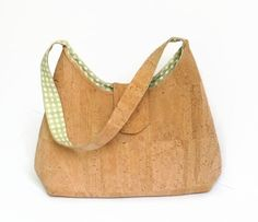 Cork Natural Eco Friendly Handmade Purse Shoulder Bag  Cork is a 100% natural product extracted from the evergreen cork oak trees (Quercus Suber) that grow in Mediterranean countries, especially in Portugal. When a cork oak reaches 25 years old, a 2.5 cm thick layer of cork bark is extracted without damaging the tree or its ecosystem. After sterilization, cork bark is pressed flat into a thin cloth.  As light as a feather and as durable as leather, cork is an eco friendly product, 100%…