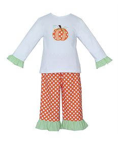 Perfect for petite princesses, this set can't wait to show off its whimsical appliqué when presiding over a playground castle. The pants come equipped with an elastic waistband, ensuring quick changes that leave plenty of time for royal ruling. Includes tee and pants100% cottonMachine wash; tumble dry