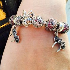 3776f26bf911 The PANDORA Disney Jewelry Collection has us swooning with Mickey ears  dangling off bracelets