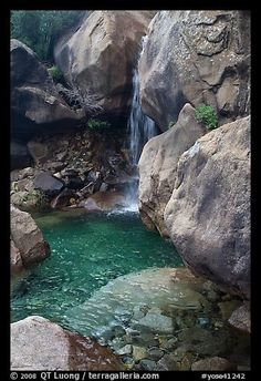 Waterfall and pool at the base of Wapama falls. Yosemite National Park, California, USA.