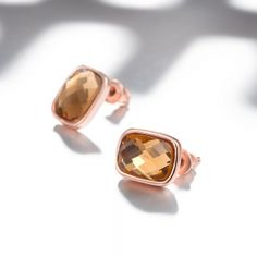 Italian Rosegold Plated Elegant Orange CZ Stud Earrings. Lead/Nickel Free Size: Earring Dimensions:1X1.2CM  Material: Top GradeCrystal Weight(grams): 3.80 Back Closure: Butterfly Back Spoil yourself or someone you know with this beautiful irresistible piece, for any occasion and sure to get a lot of attention!Special gift idea. No matter if you're shopping for your own mother, or your grandmother, wife, daughter, or granddaughter, touch their heart with this beautiful, stunning and unique…