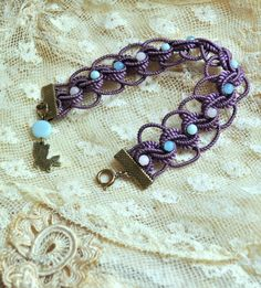 handmade bracelet with braided antique trim and by lacemonster816. $20.00 USD, via Etsy.