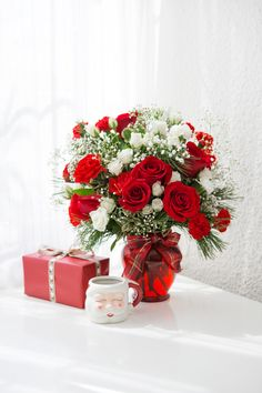 White spray roses and red miniature carnations are accented with tips of douglas fir, holly and red berry spray. Teacher Christmas Gifts, Teacher Gifts, White Spray Roses, Christmas Flowers, Local Florist, Christmas Centerpieces, Flower Arrangements, Floral Wreath, Bouquet
