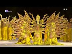 Thiên Thủ Quan Âm (Thousand Hand Guan Yin) All of the dancers are complete deaf-mutes.  Relying only on signals from trainers at the corners of the stage, these extraordinary dancers deliver a visual spectacle that is at once intricate and stirring.  Its first major international debut was in Athens  at the closing ceremonies for the 2004 Paralympics.