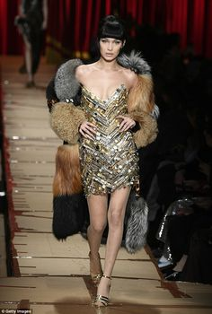 Dazzling display: The sixties-inspired party ensemble was jazzed up with a faux-fur jacket...