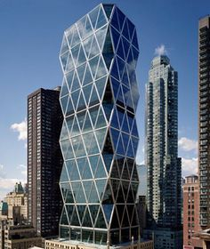 World's Most Beautiful Building  Hearst Tower, New York City    Magic Revealed: In the lobby, you can see how the steel structure supports the tower that appears to float above its six-story Art Deco base.
