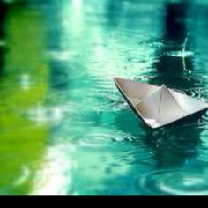 Little paper boat in the rain