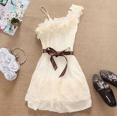 Gorgeous ivory dress with brown ribbon