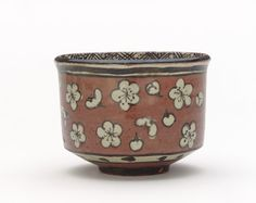 Kenzan-style tea bowl with design of plum blossoms late 19th century Ogata Kenzan , (Japanese, 1663-1743) Meiji era Red earthenware with white slip and iron pigment under transparent lead glaze H: 8.1 W: 10.6 cm Kyoto, Japan