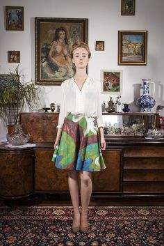 "skirt, a painting by Szymon Szelc entitled ""White, wild monkeys""; photo: Dawid Kot, model: Anna Maria Marylska;"