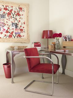 A vintage chair reupholstered in red corduroy