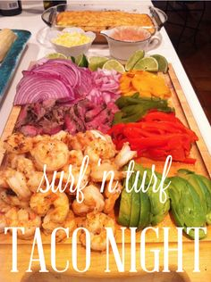surf 'n turf taco night. I love the idea of laying it all out. I would do also with some chopped cilantro and a great salsa.