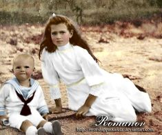 Who: Grand Duchess Maria Nikolaevna of Russia with the son of a sailor What: Colouring of an original black-and-white photograph When: 1910 Where: Finland