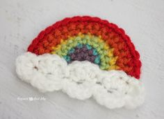 These are cute. I love how they look with the tails still attached. I thought you could even leave the tails at different lengths and attach individual clouds on them, giving a mobile type look~~~ Repeat Crafter Me: Crochet Rainbow Applique
