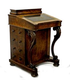 A 19th century figured walnut Davenport, with fitted superstructure over four dummy and four true side drawers, on 'S' scroll supports, 55cm wide.