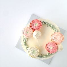Buttercream ranunculus on a wreath of baby's breath. Simple and sweet.