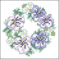 Pansy Wreath - looks like it might fit into the back of a handbag mirror or coaster etc., and it would look really pretty in either, I think.  Chart free from Janlynn.