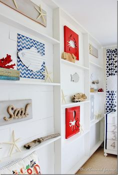 A bright and playful nautical wall with shelving and art.