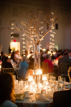 The candles around these tall centerpieces are breathtaking.