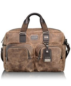 Tumi distressed leather carry-on  is a stylish travel companion for the alpha male.
