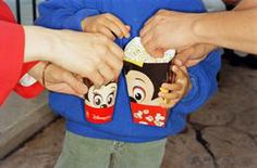 FRANCE. Paris. Disneyland. Popcorn. 1998.