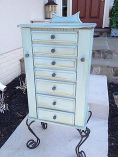 Jewelry armoire painted in Duck Egg with Graphite knobs.