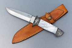Knife by: Paolo Gidoni  Engraved by: Lionello Sabatti  Overall length: 240 mm  Materials: 440C, mother of pearl.