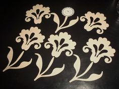 die cut chipboard flowers and stems.