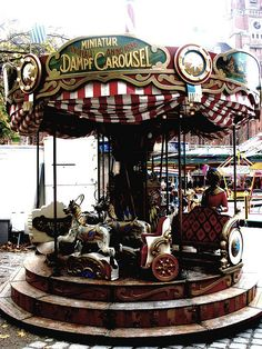 An old miniature, steam carousel at the traditional annual market fair in Munich. It's so sweet!