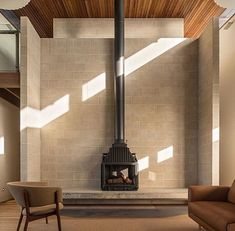 Here's a stunning space shared by An elevated kitchen featuring a floating staircase with our Radiante 846 placed in… Fireplace Hearth, Fireplace Design, Metal Garden Gates, Limestone Wall, Mountain Decor, Floating Staircase, Fireplace Remodel, Wood Burner, Building A New Home