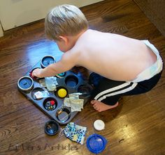 Discovery & Play muffin pan activity, so creative - This is a new favorite in our household. I set it up on the coffee table, and Tyler will play with it for 30 minutes or more - a record for us!