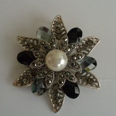 Black and Gray Vintage Floral Shaped Brooch with Pearl Center can also be worn as a Pendant. Priced at $25.00 See more photos at our online store at www.CCCsVintageJewelry.com We are now shipping to the US and Worldwide except for Russia. We are also sending a thank you coupon that gives you a discount of $25.00 towards a purchase of $100.00. This brooch can also be worn as a pendant and is large in size. It is set in silvertone metal. Gorgeous Piece. Have an AMAZING Day!  Txs, Coco
