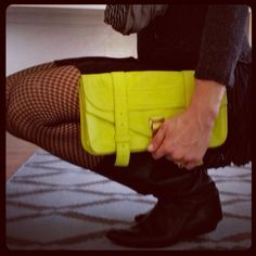 Brightening up a my mother's boots in my @stitch fix dress with my #neon #proenzaschouler #clutch