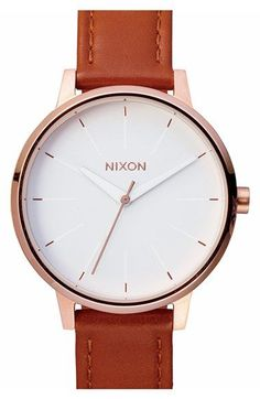 A slender rose gold bezel and slim etched indexes lend understated class to this round leather-strap watch that strikes a classic note in timeless hues and textures.