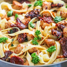 Lemon Chicken Fettuccine - a refreshing pasta recipe made with chicken, sun-dried tomatoes, herbs and a light lemon dressing.