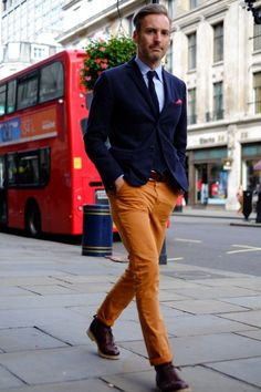 Beige chinos and navy jacket. Simple stylish hair