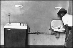 """North Carolina, 1950. """"This is probably one of my better pictures. The """"White"""" and """"Colored"""" drinking fountain united by one pipe, but a refrigerated one for """"White"""" people and one messy, ugly, dirty one for """"Colored"""" people. This was taken in North Carolina in the 1950's. It's a picture that's been used quite a lot in history books as an illustration to show graphically the myth of separate but equal, which was the mantra of the time in the South. """""""