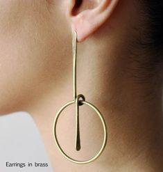Earrings | Art Smith.  Brass