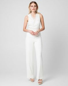 Lace & Tricoteen V-Neck Jumpsuit - Beautiful lace defines the wrap-like bodice of a V-neck jumpsuit finished with a chic wide leg.