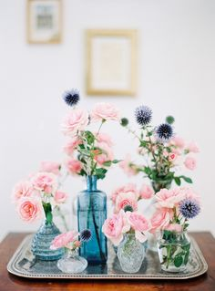floral home decoration...mixed blue vases with pink roses and blue thistles...
