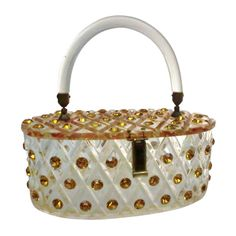 1950s Lucite Oval-Shaped Box Bag Studded w/ Topaz Rhinestones    COUNTRY: United States DATE OF MANUFACTURE: 1950's CONDITION: Excellent WEAR: Wear consistent with age and use WIDTH: 8 in. (20 cm) DEPTH: 4 in. (10 cm) HEIGHT: 3 in. (8 cm)