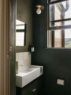 Stylish new holiday rental in Bath offers a cosy place to staycation in the UK - photo Toby Mitchell - beige interior - green bathroom